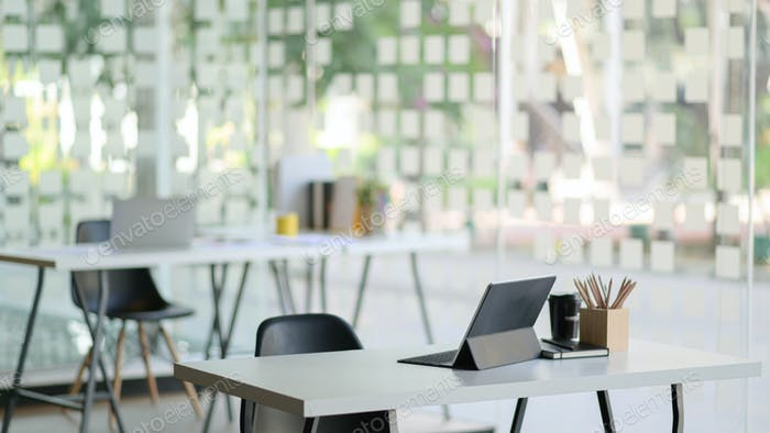 Contemporary workplace with modern tablet and office supplies.