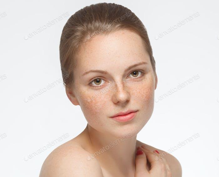 Woman beauty face freckles beautiful skin