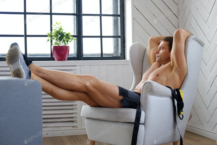 A man relaxing in a chair.