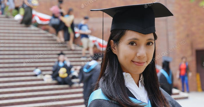 Woman with graduation gown in university gown