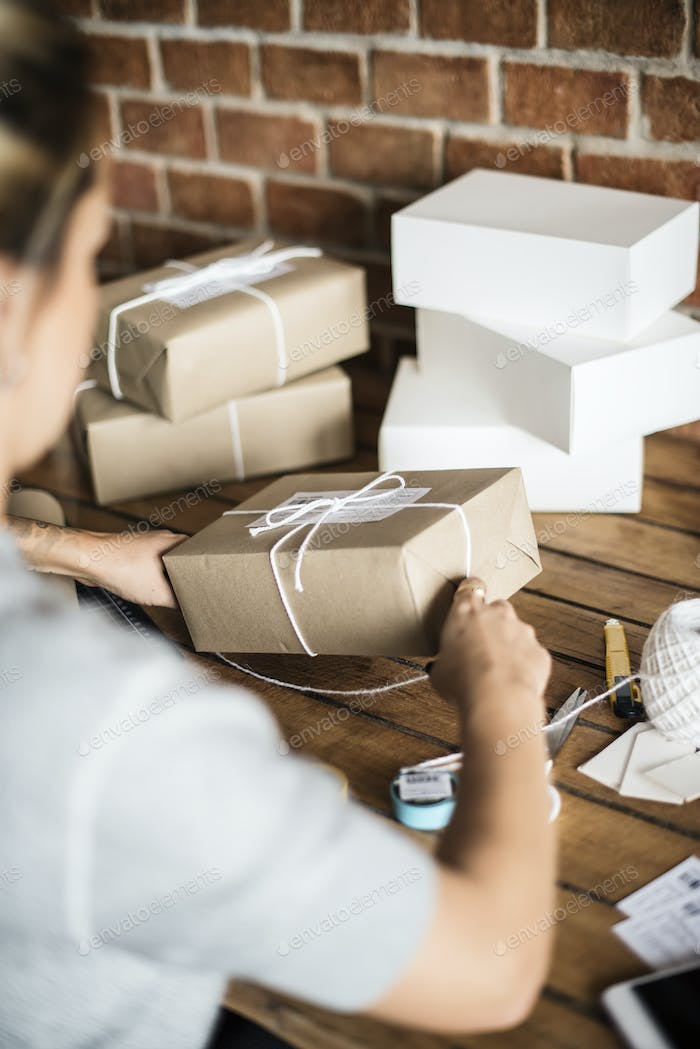 Woman packing parcels