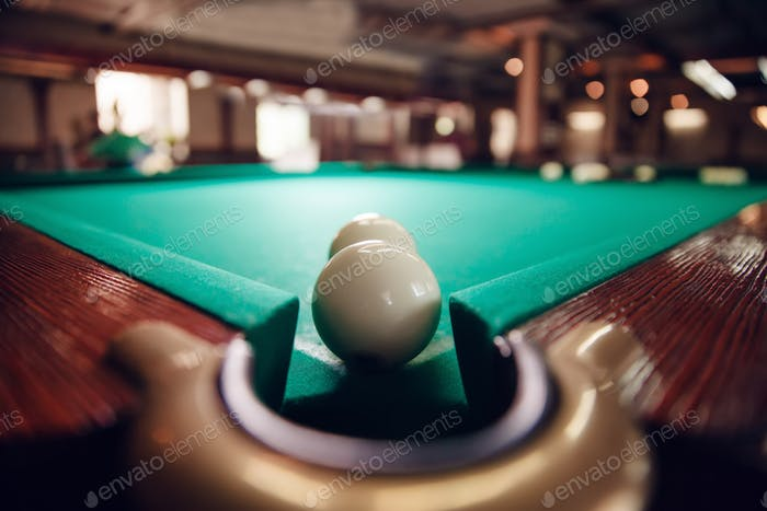 Billiard balls near pocket