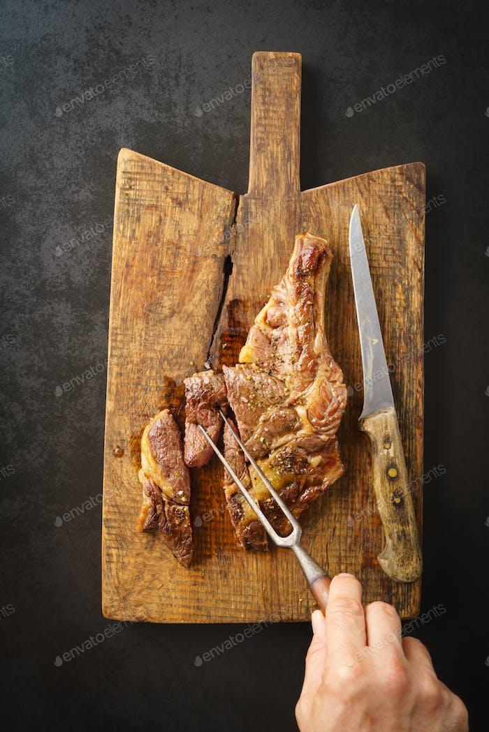 Steak on wooden board