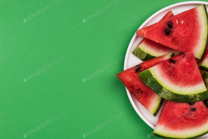 Fresh Watermelon Sliced in Triangles on Plate, Pastel Background