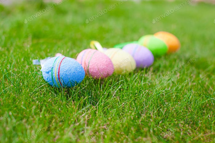 Colored easter eggs in the grass