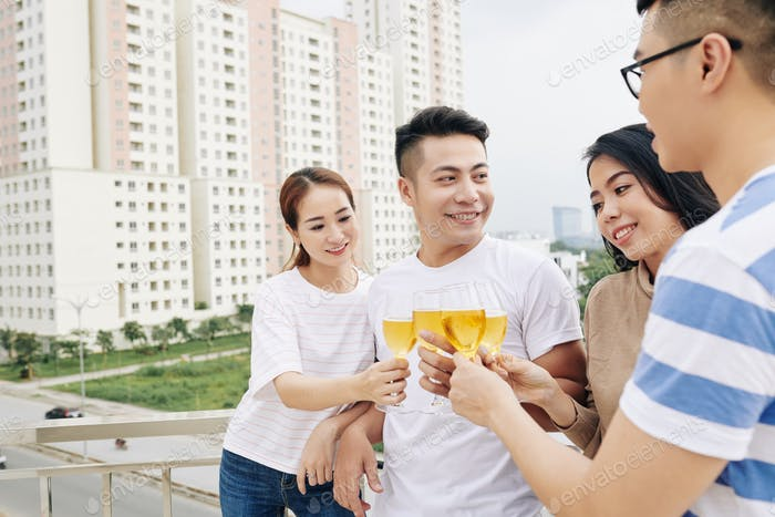Asian people enjoying rooftop party