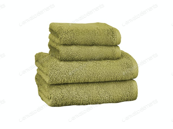 Pile of colored towels isolated on white