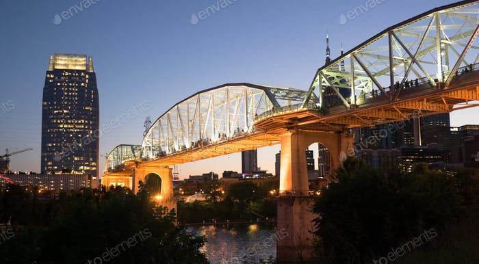 People Walk Across Cumberland River Pedestrian Bridge Nashville