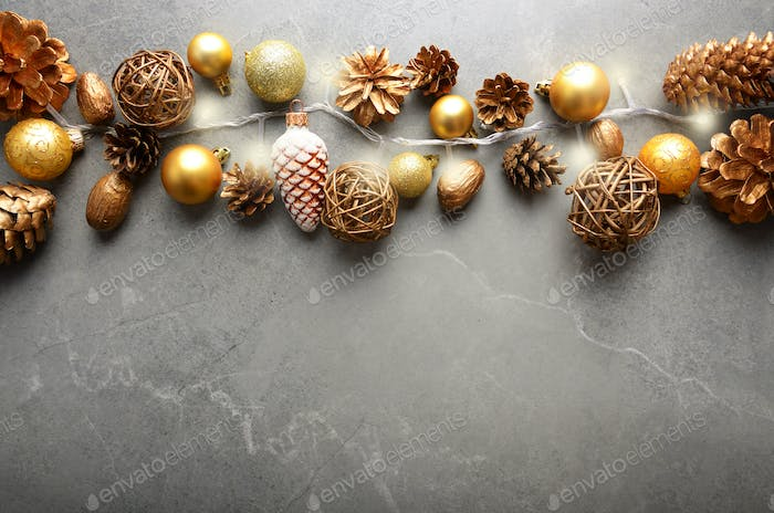 Flat lay view at Christmas decorations of gold and yellow cones
