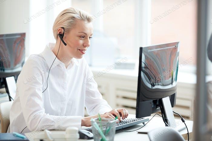 Female Operator in Call Center Office