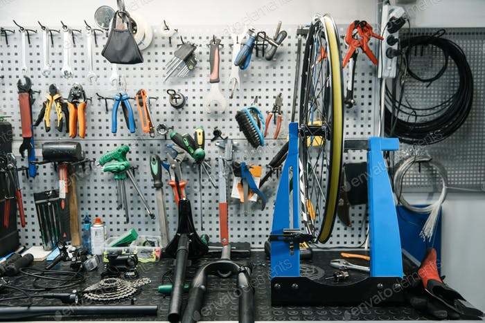 Bicycle workshop interior, tools on the wall