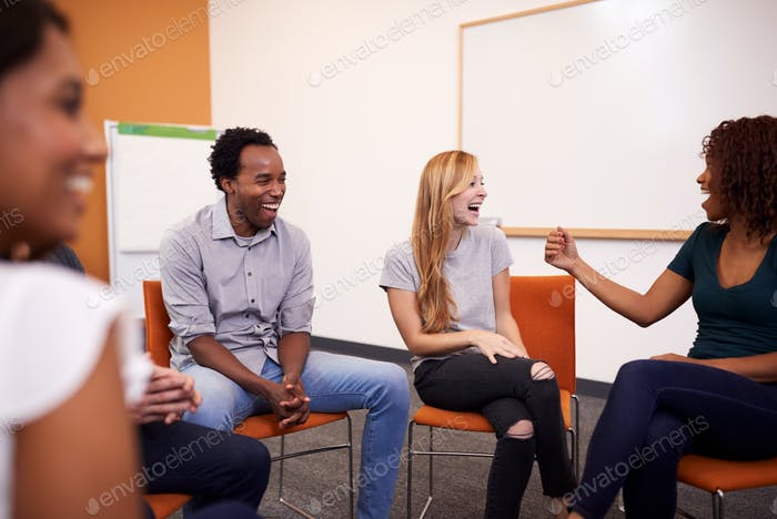Multi-Cultural Group Of Men And Women At Mental Health Group Therapy Meeting