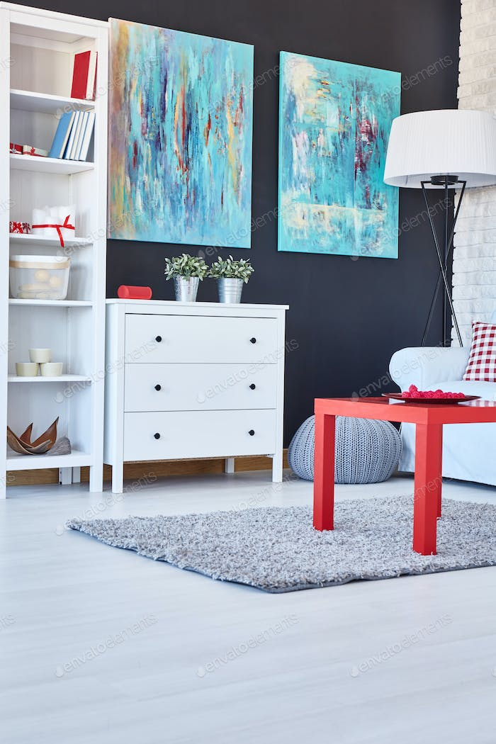 Room with navy walls and red table