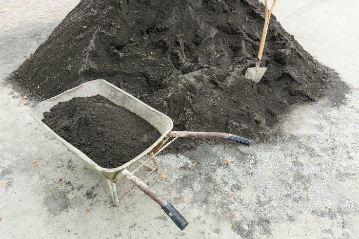 Shovel for construction works on a heap of old asphalt