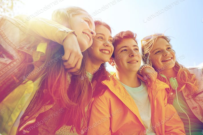 happy teenage students or friends outdoors