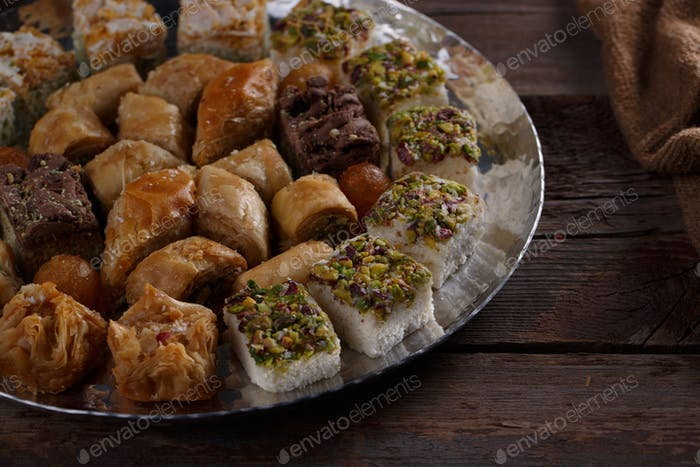 Traditional baklava and delights, close view, dark photo