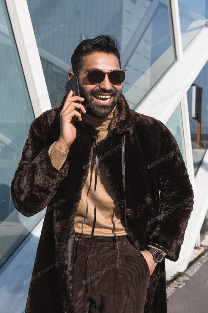 Young Indian man talking on phone