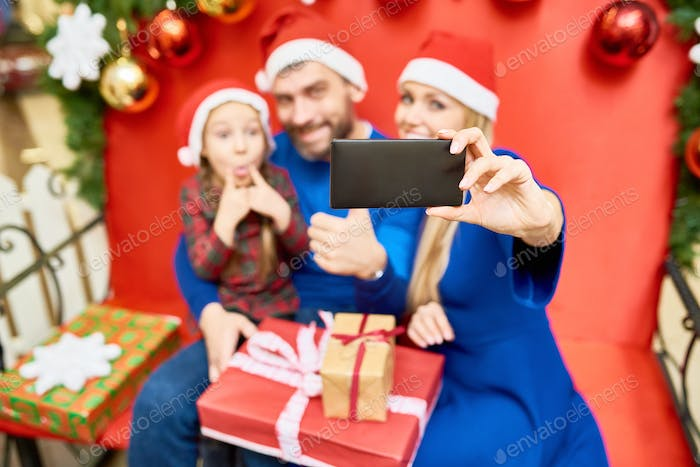 Family taking selfie while celebrating Christmas