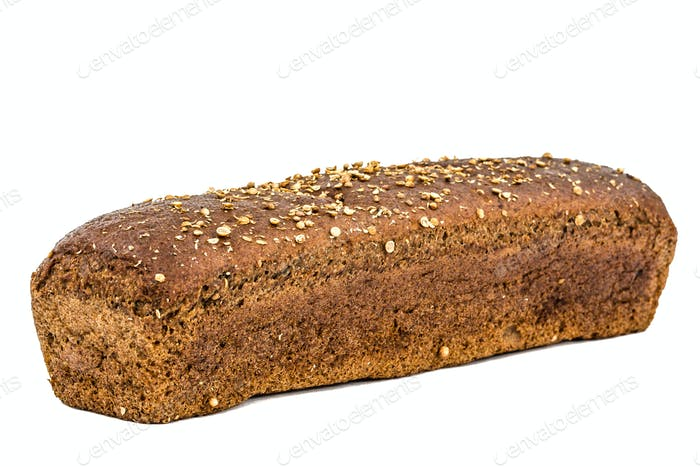 Loaf of bread made of dark flour, isolated on white background