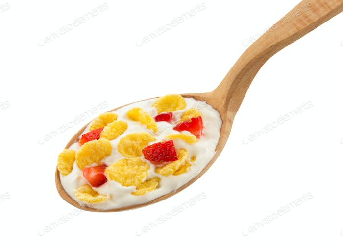 corn flakes in spoon