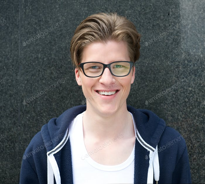 Modern young man with glasses smiling