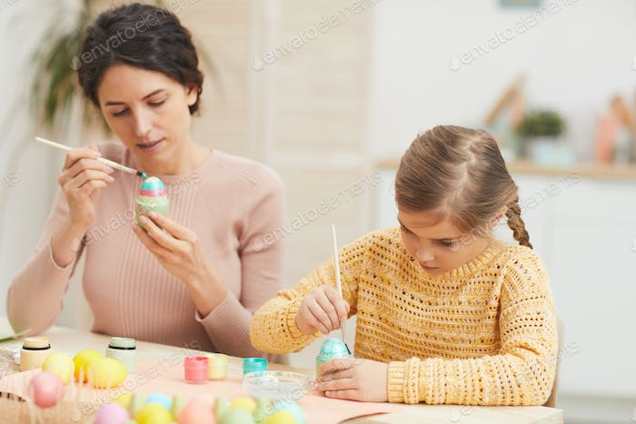 Family Painting Easter Eggs at Home