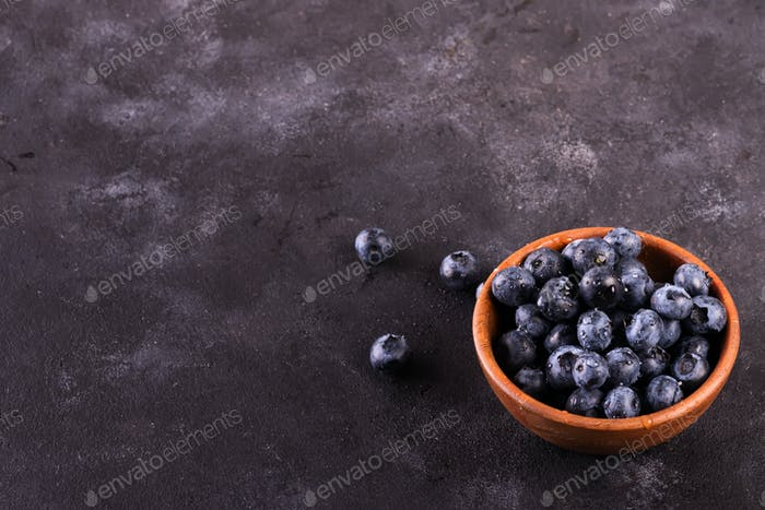 Blueberries in a bowl on a stone table