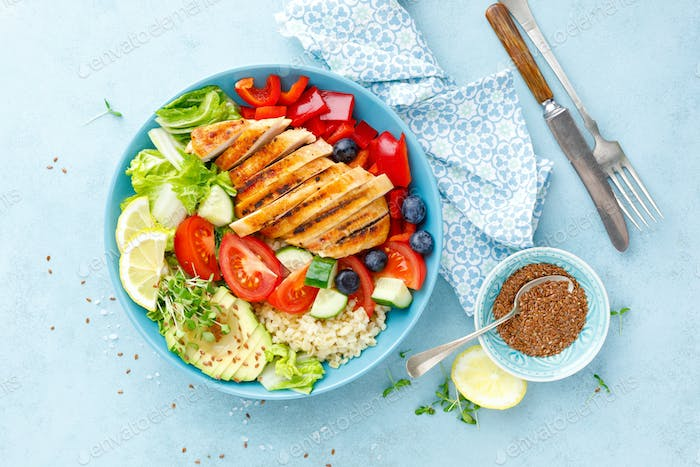 Lunch bowl with grillet chicken breast, fillet, bulgur and fresh vegetable salad