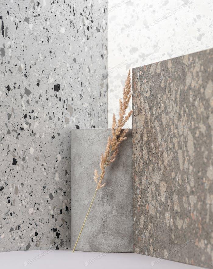 Composição interior moderna usando várias texturas de pedra e plantas secas.