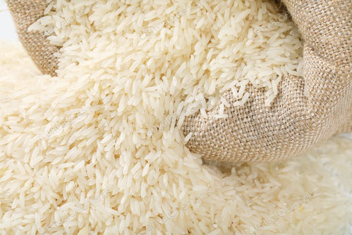 bag and pile of white long grained rice