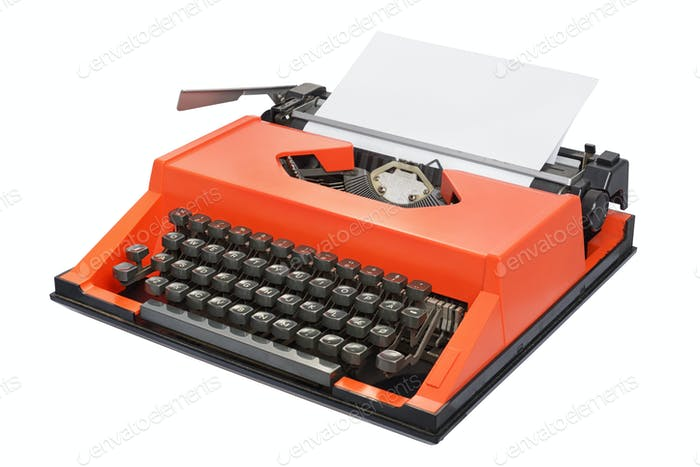 Red typewriter isolated on white background