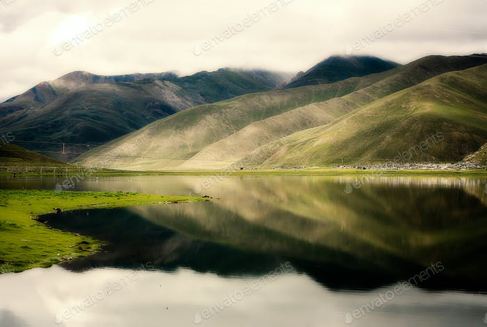 Hills reflected in a lake