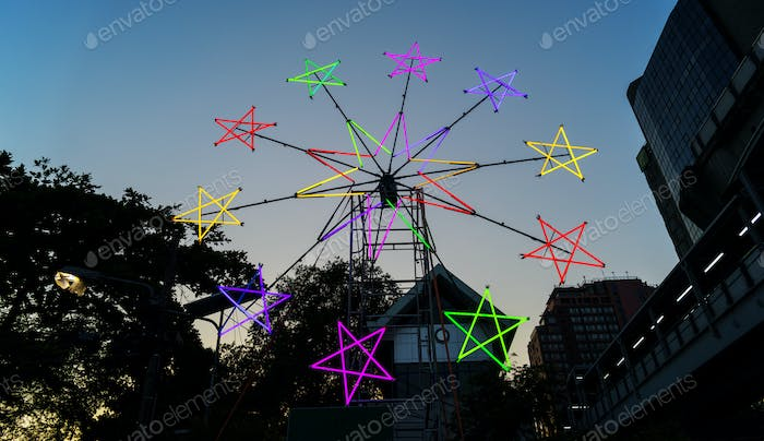 Star shaped neon windmill in a festival