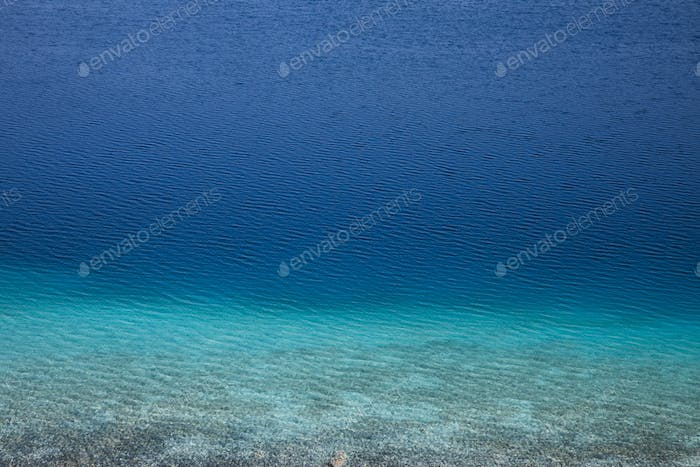 full frame view of beautiful calm blue water