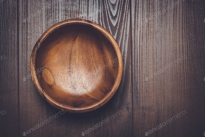 salad bowl on the  brown wooden table