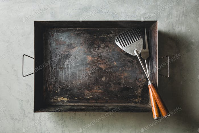 Empty baking sheet with fork and Spatula for Grill, Top view