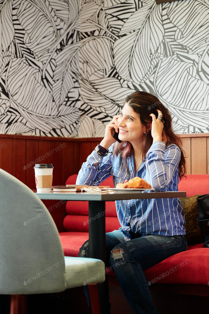 Woman scratching head and calling on phone