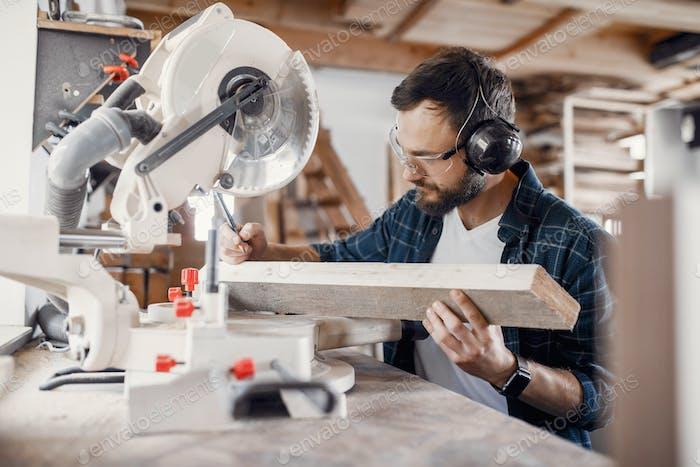 Carpenter working with circular saw