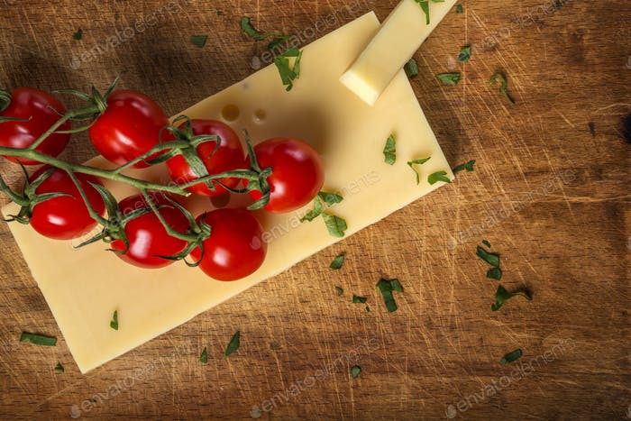 Emmental cheese with cherry tomatoes