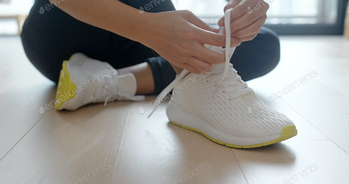 Woman wearing sport shoes at home