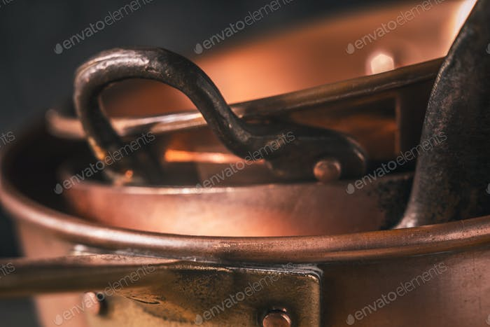 Copper pots and pans close-up