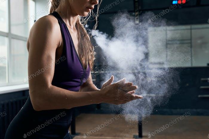 Woman Using Chalk Before Intense Training