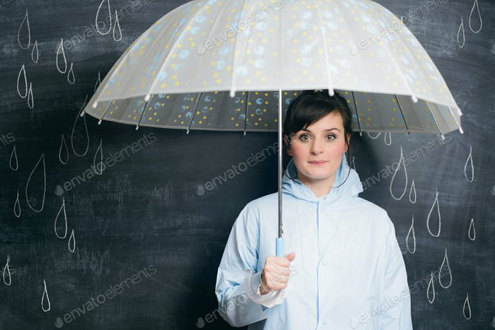 woman under umbrella on drawn raindrops background