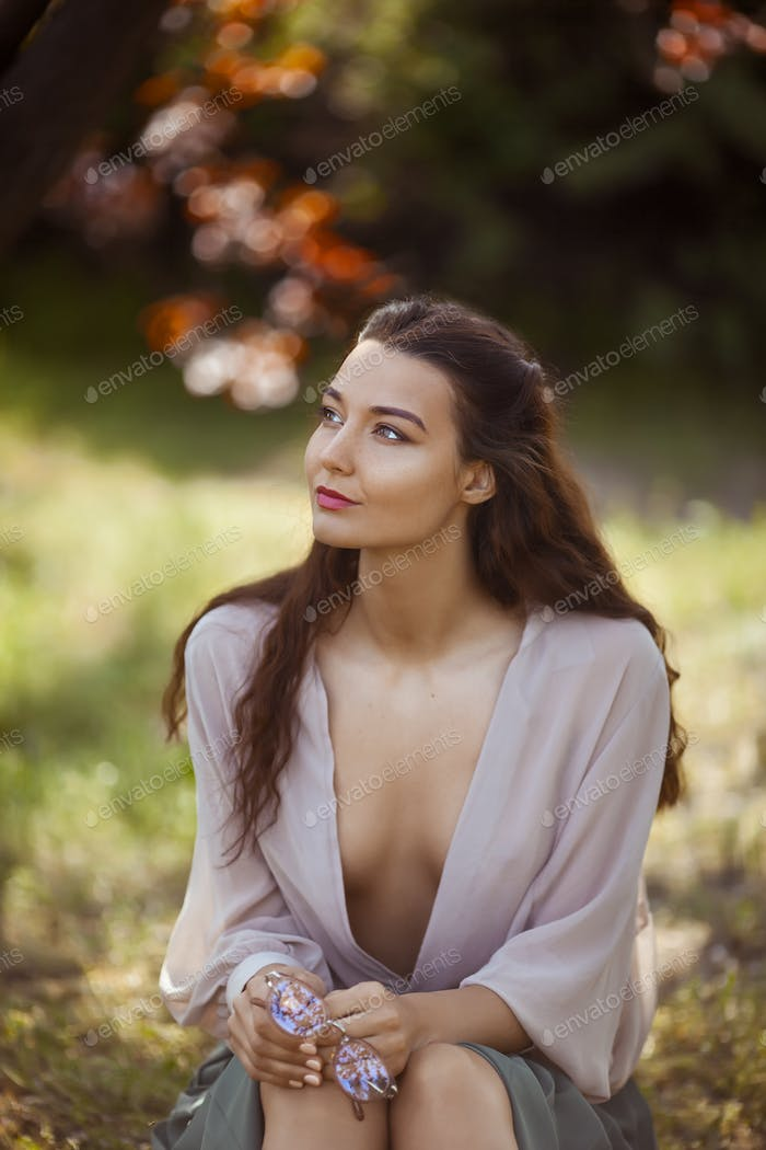 Woman Outdoors in Park on Sunny Day