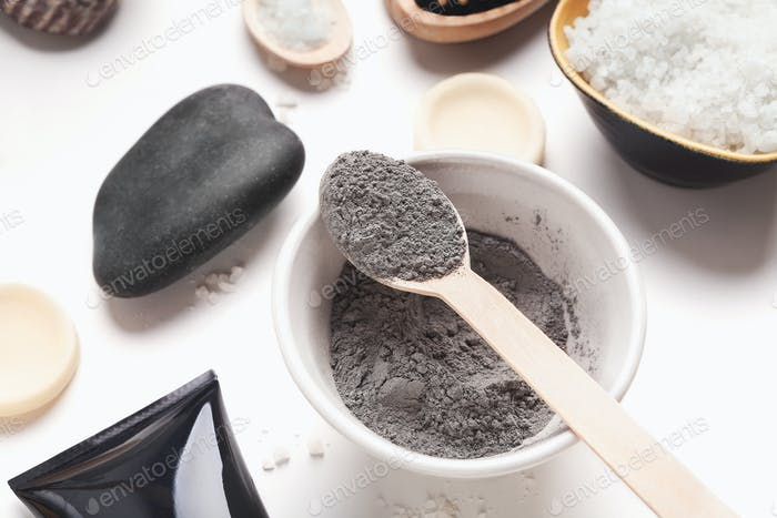 Preparing natural cosmetic black mask in bowl