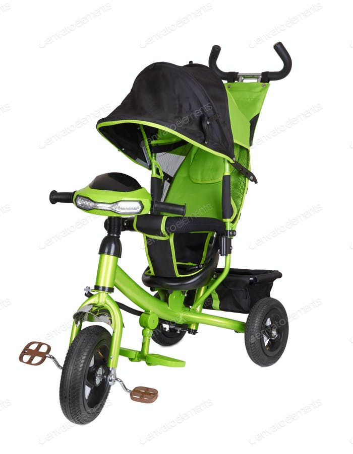 Green tricycle isolated