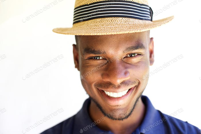 Cheerful young man in hat
