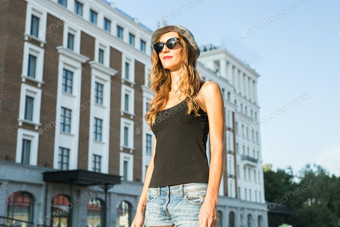 lifestyle fashion portrait of young stylish hipster woman