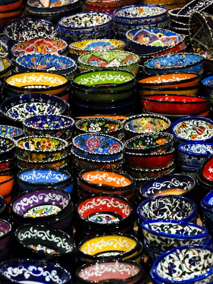 exposition with lot of coloured hand made touristic souvenir dishes for the table