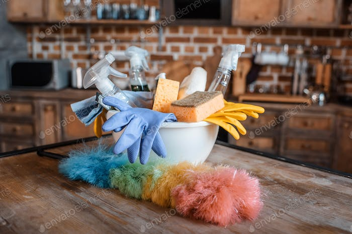 Close-up view of cleaning supplies on wooden table indoors
